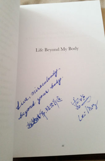 "Title page with inscription from Lei Ming (Ray) that reads, ""Live miraculously beyond your body"" in English and Chinese above Ray's signature."